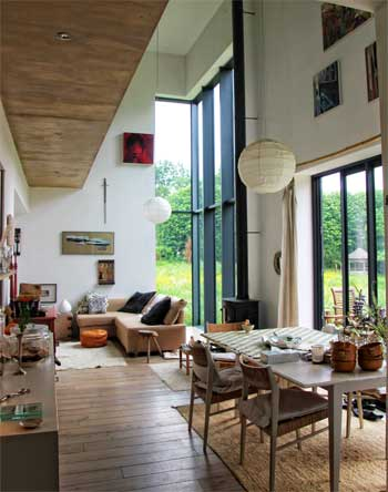 Modern room in a house with large windows overlooking the countryside of northern France