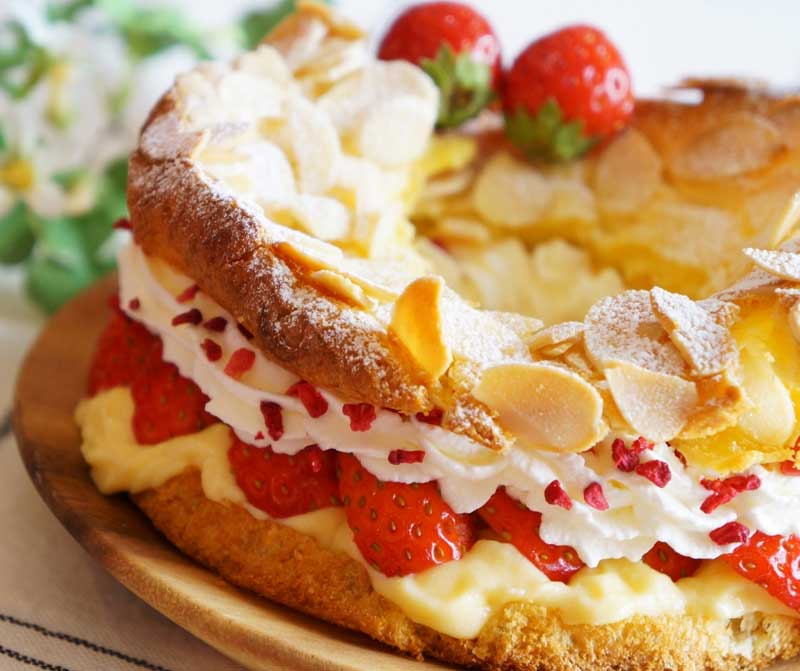 Paris Brest cake filled with cream and fresh strawberries