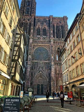 Towering pink stone cathedral smothered in stained glass windows, Strasbourg, Alsace