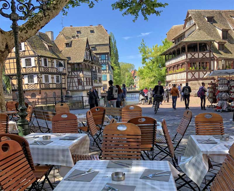 Half timbered houses on a cobbled square in the Petite France district, Strasbourg, Alsace