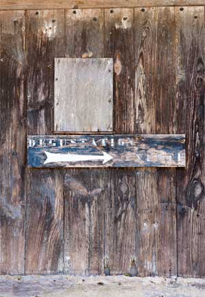 "Old wood paneled door with the word ""degustation"" meaning wine tasting"