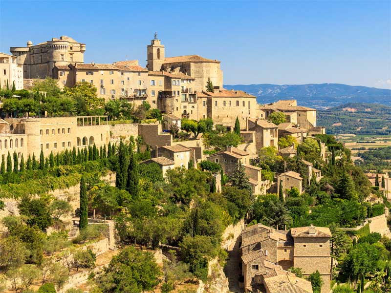View of the town of Saint-Remy de Provence, ancient stone buildings perched on a hill
