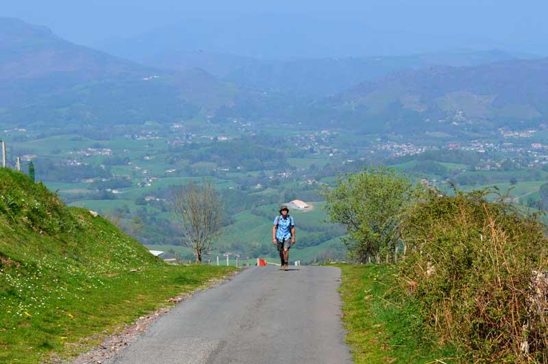Man walking down an empty road in rural France - not a soul in sight