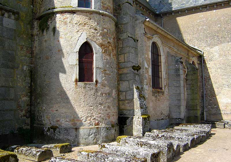Stone sarcophogi that are centuries old laid alongside church walls in Quarry-les-Tombes, Burgundy