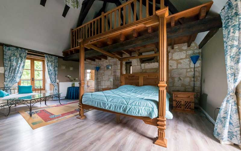 4-poster bed in a luxury bedroom at a Chateau holiday home in Dordogne