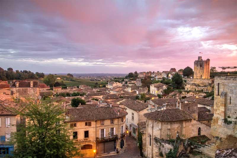 Pink sky at dusk over the hill top town of Saint Emilion, Bordeaux