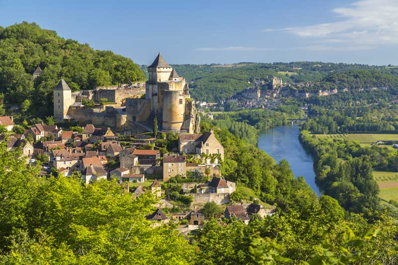Castle on hill overlooking a long winding river, Dordogne