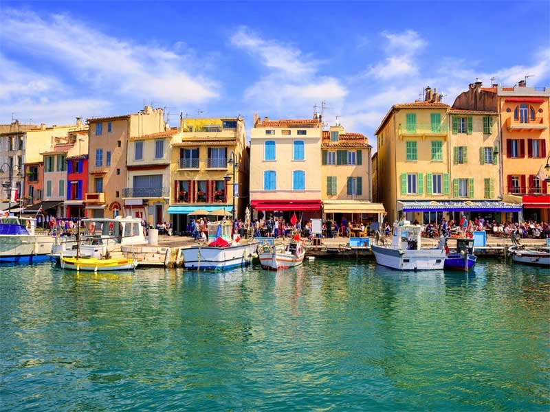 Shops and restaurants along the waterfront at Cassis, south of France on a sunny day