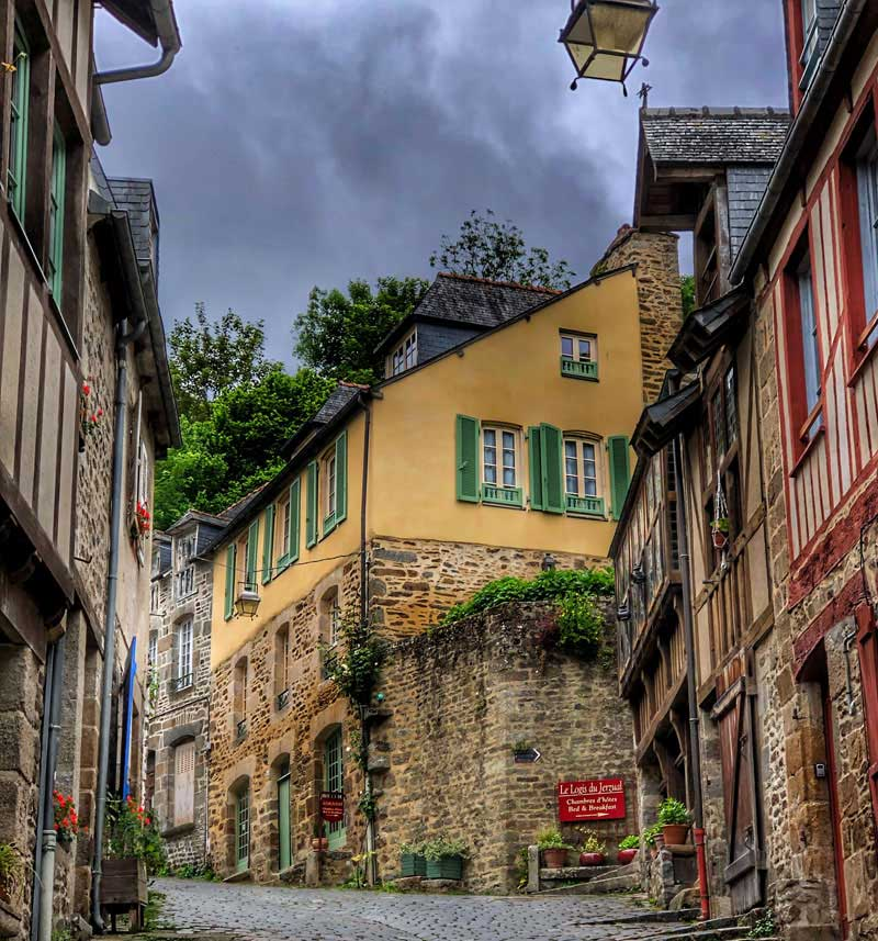 Old style lampposts on a cobbled street in Dinan, Brittany
