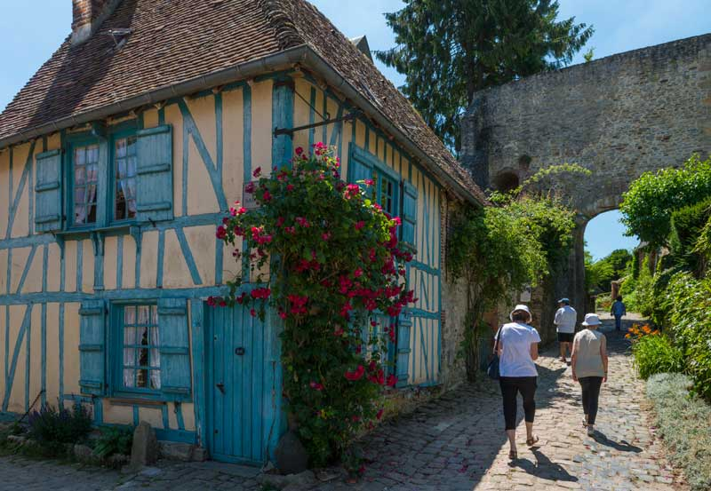 Beautiful half timbered house in Geberoy, Picardy, France, roses growing up its walls
