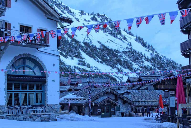 Dusk falls on a mountainside where a bar offers stunning views over the snowy slopes