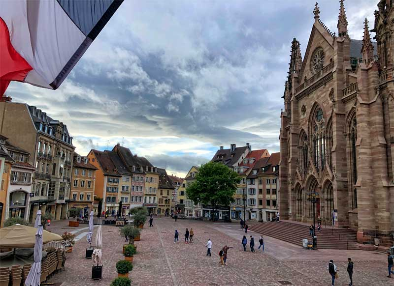 Place de la Republique, the main square in the small city of Mulhouse, Alsace with church and shops