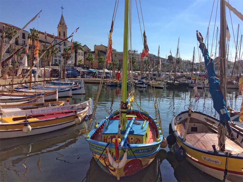 Beautiful port of Sanary-sur-Mer, southern France, colourful wooden boats and stone buildings