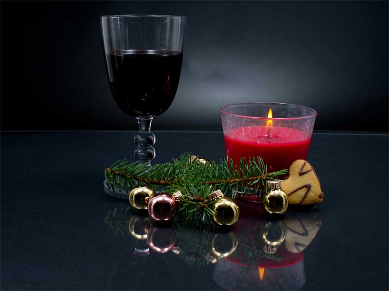 Glass of red wine with a Christmas decoration