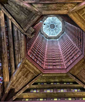 Looking up into the great tower of St Joseph's Church Le Havre, thousands of tiny stained glass windows