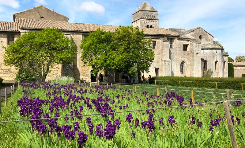 Stone building, St Paul de Mausole, surrounded by fields of lavender and irises, Provence