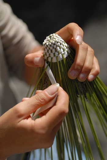 weaving ribbon into lavender sprigs, an ancient craft in Provence