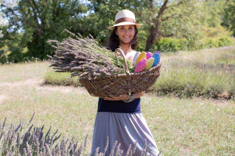 Woman holding basket of lavender
