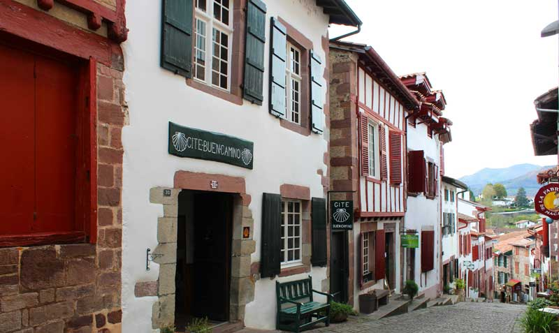 Street in the Basque area of Pyrenees-Atlantiques, half timbered buildings on a cobbled, hilly street