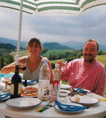 Man and woman dining al fresco in Midi Pyrenees