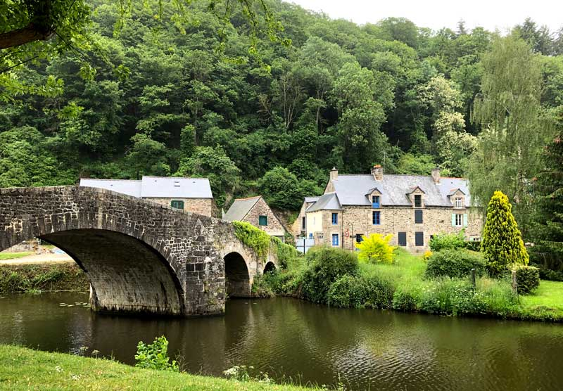 Ancient stone bridge over a river in Lehon near Dinan, Brittany