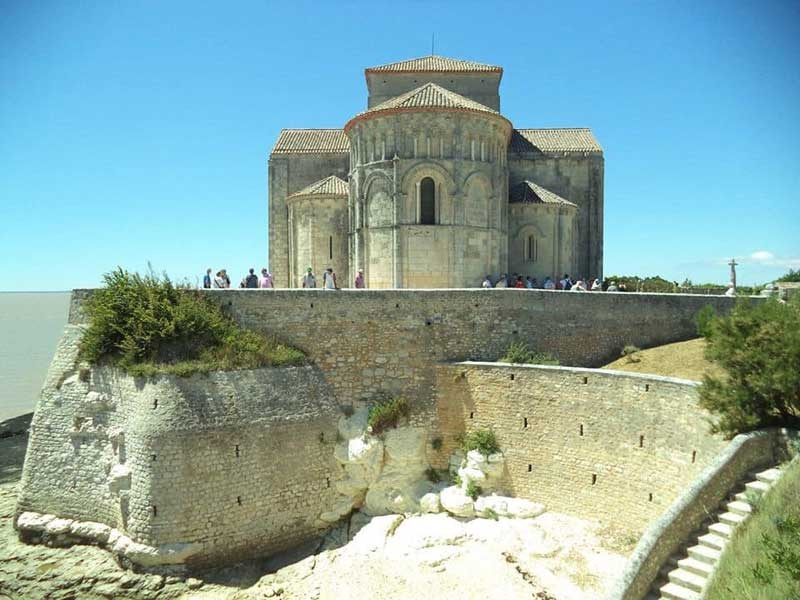 Church of Sainte-Radegonde, Talmont-sur-Gironde, white stone against a dark blue sky