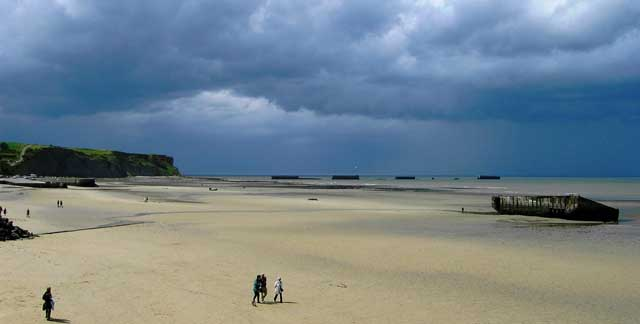 Beach at Arromanches-les-Bains, Normandy where WWII harbour remnants can still be seen