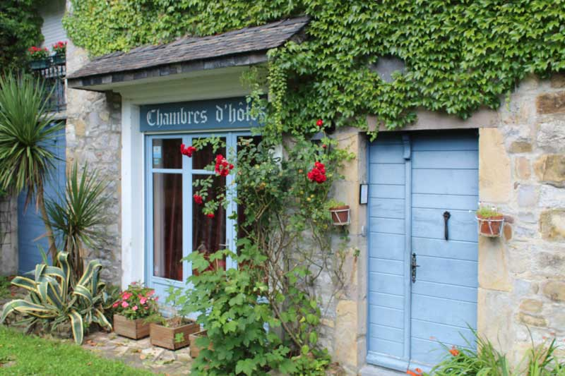 Pretty B&B in Pyrenees-Atlantiques, ivy and roses climbing over pale stone wall