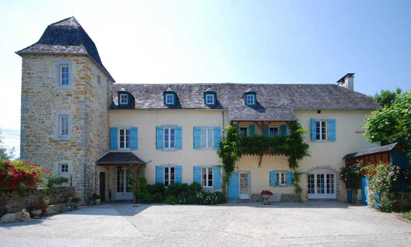 Typical chateau style in Pyrenees-Atlantiques, pale stone and blue shutters, plus large courtyard