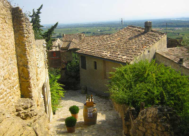 Cobbled street in Chateauneuf-de-Pape, Provence, surrounded by vineyards