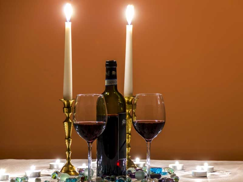 Bottle of wine with two candles