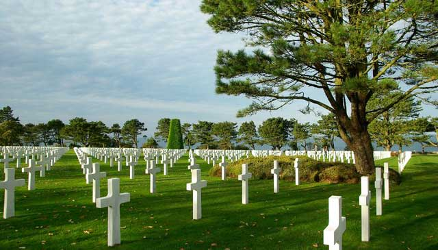 Row upon row of white crosses in the American Cemetery in Normandy