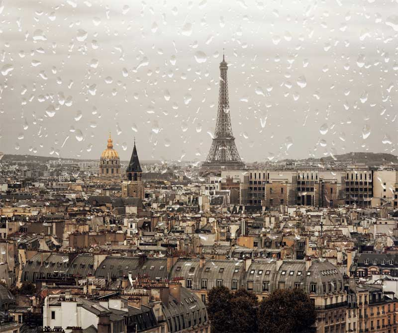 Eiffel Tower and roof tops of Paris on a rainy day