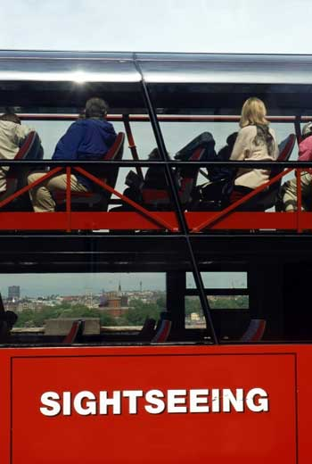 People sitting on a site seeing bus in Paris