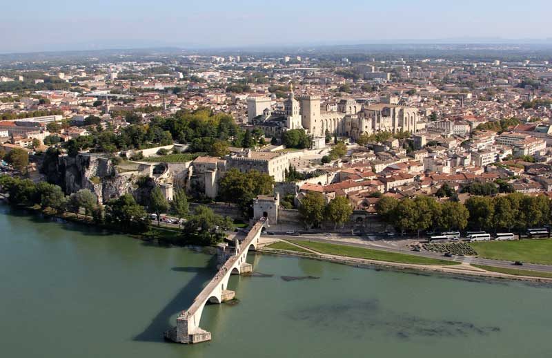Aerial view of Avignon city, Provence, France, huge palace of the popes dominates the town