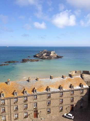 View over Saint Malo, stone houses on the edge of the sandy beach, Brittany