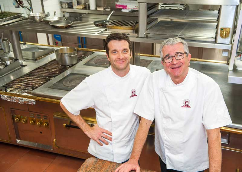 Old and young chef pose together in their kitchen at La Matelote, Boulogne-sur-Mer