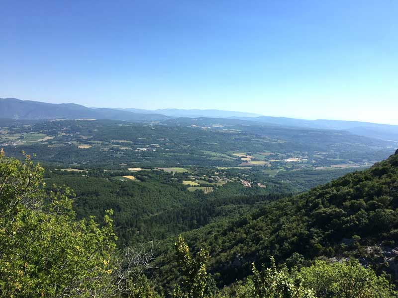 View of the Haute Alpes, Provence, hilly landscape with forests and small hilltop villages