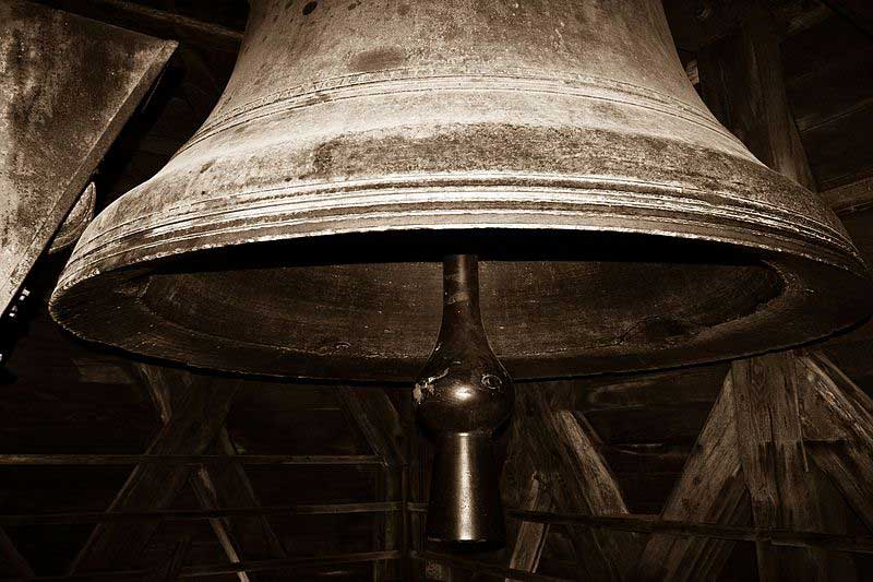 Giant metal bell hanging from the roof of Notre-Dame Cathedral, Paris