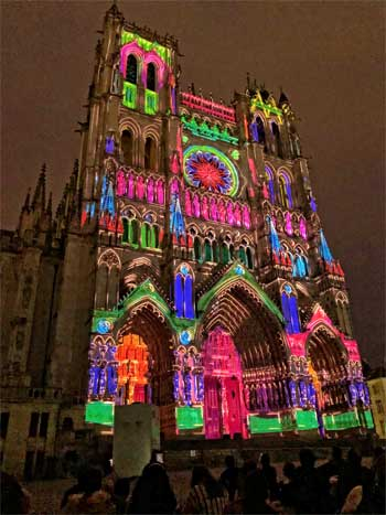 The Gothic Cathedral of Amiens lit up at night