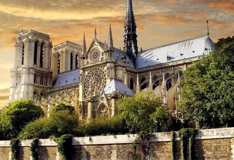 Notre Dame Cathedral Paris under glowing sunset