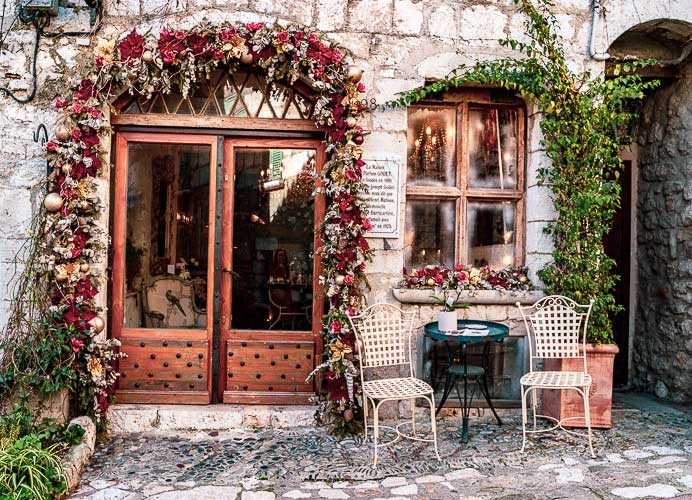 Terraced cafe with roses hung around the door in St Paul-de-Vence, Provence