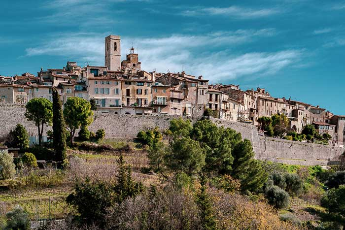 View of the hill top village of St Paul-de-Vence Provence, a wall around the town surrounded by trees