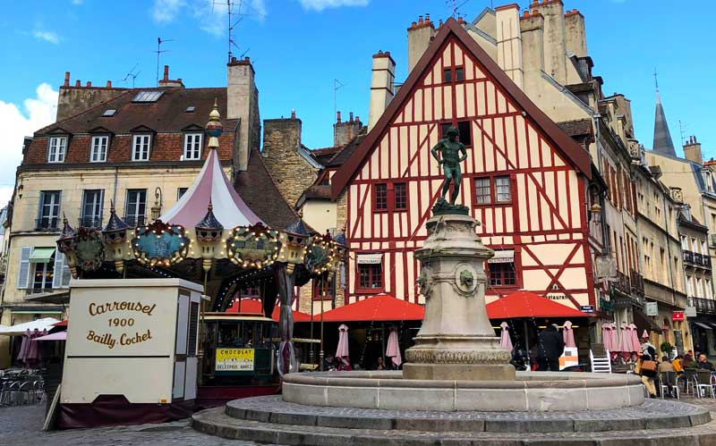 Statue of a vineyard worker stomping a barrel of grapes, Dijon