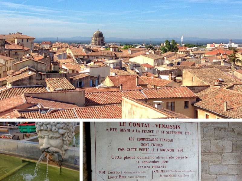 Terracotta rooftops of Carpentras in Provence contrast with a deep blue sky