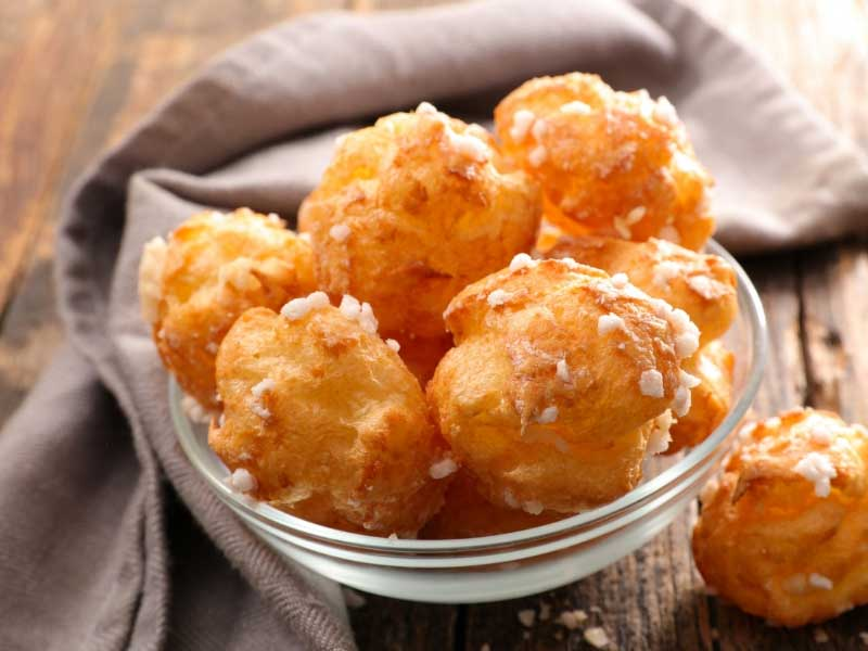 Bowl of chouquettes, small cream puffs made from choux pastry and baked with crystal sugar sprinkles