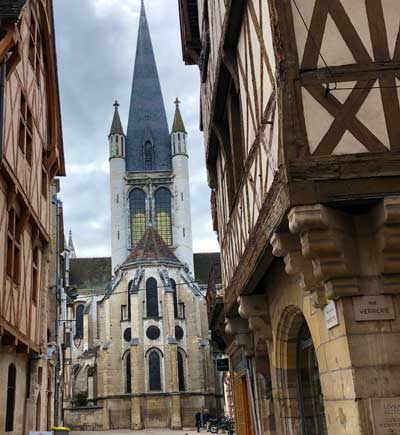 Church with a very tall thin tower, sides covered with gargoyles, Dijon