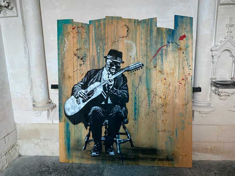 Painting of a blues musician playing guitar
