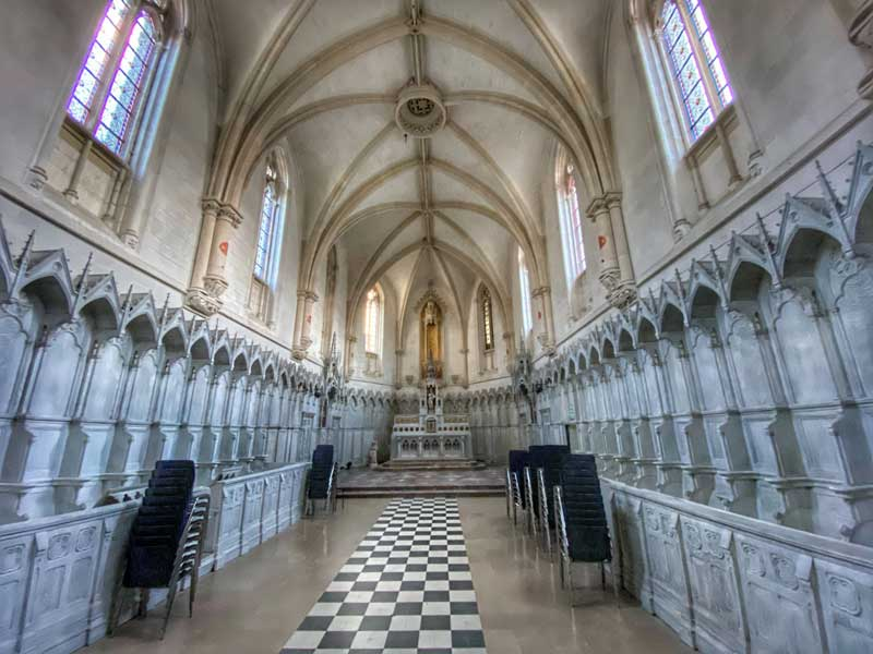 Vaulted chapel lined with Gothic style seating, Neuville Charterhouse
