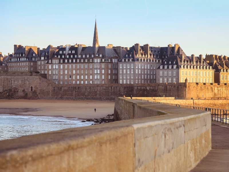 View of the ramparts of St Malo with tall buildings in the inner old town